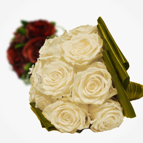 A handheld tied bridal bouquet of roses available in a choice of colours