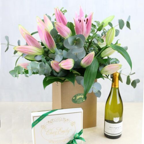 Pink lilies with a bottle of Vigerons de Buxy Bourgogne Chardonay and Chez Emily Chocolates